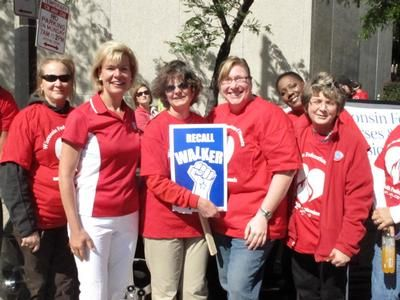 Congresswoman Tammy Baldwin poses with WFNHP parade marchers