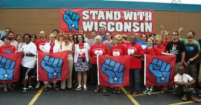 WFNHP & AFT-WI members pose with Randi Weingarten after GOTV rally